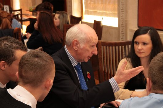 Robin Newton MLA speaking with a group of pupils
