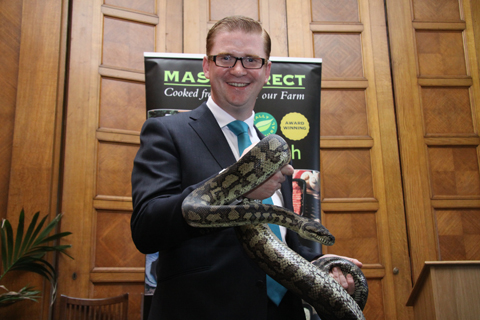 Simon Hamilton MLA holds Darwin the Coastal Carpet Python at the launch of Family Fun Day 2012